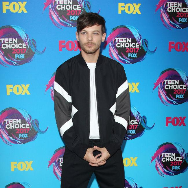 Louis Tomlinson 'devastated' by sister's death