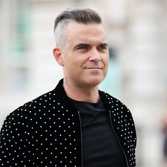 Robbie Williams tells fans to blast rival Liam Gallagher