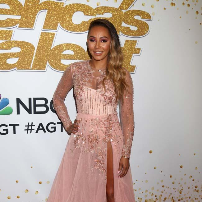 Mel B: Spice Girls used to chat while peeing