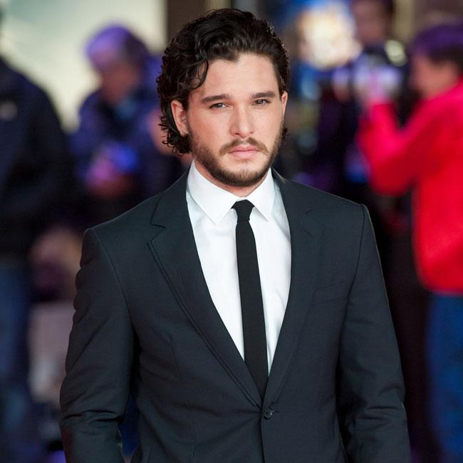 Kit Harington found Emilia Clarke kiss 'weird'