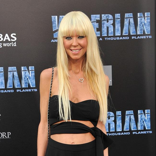 Tara Reid prefers dogs to men