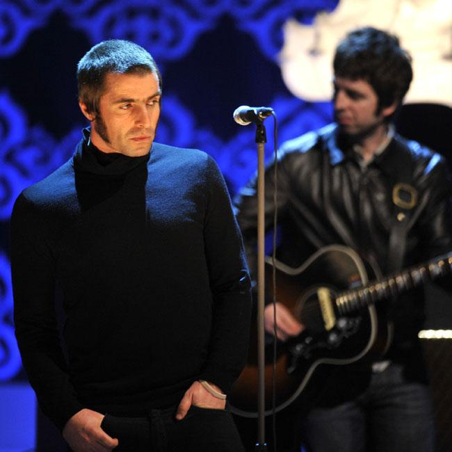 Oasis label boss Tim Abbot says Liam and Noel could 'switch on a tornado of madness'