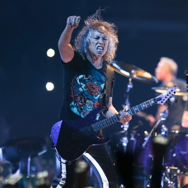 Metallica's Kirk Hammett takes a tumble on slippery guitar pedal