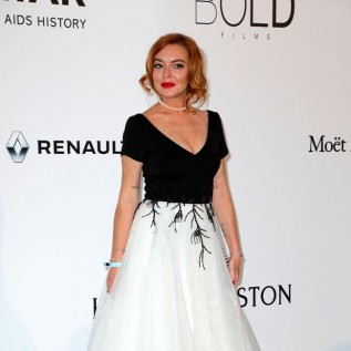 Lindsay Lohan defends beach clubs