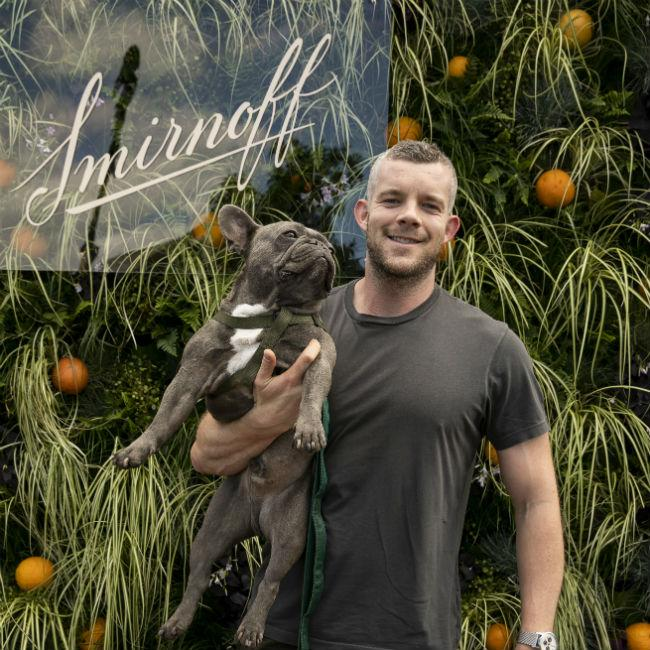 Russell Tovey parties with pooch