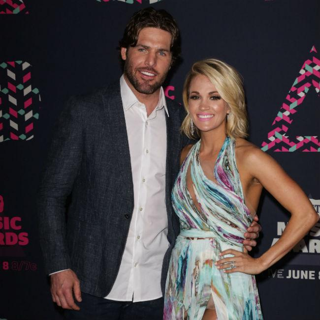 Carrie Underwood and Mike Fisher enjoy quiet anniversary