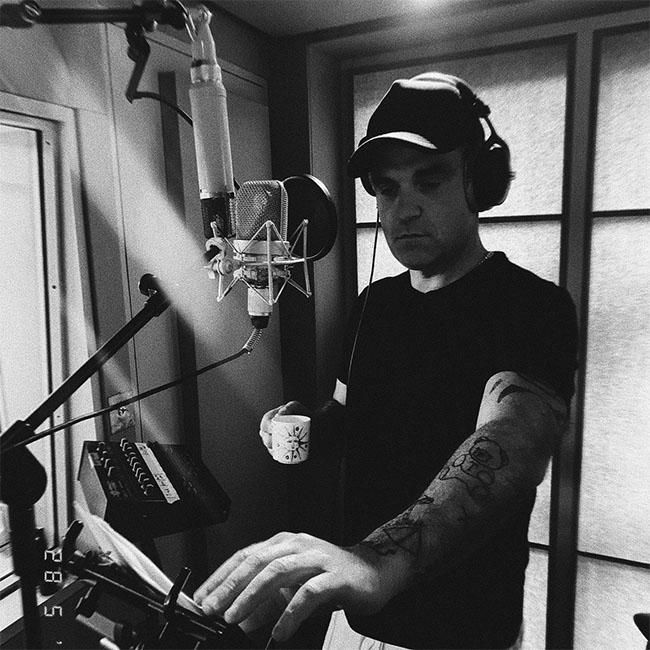 Robbie Williams teases new music