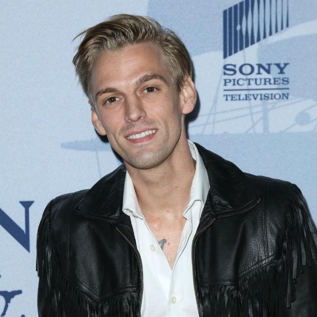 Aaron Carter is giving up his assault rifles