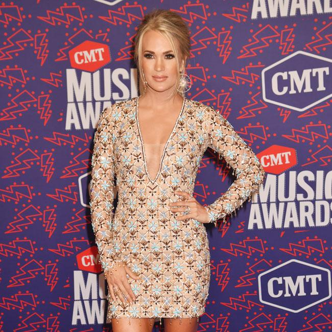 Carrie Underwood won't let her husband listen to her music early
