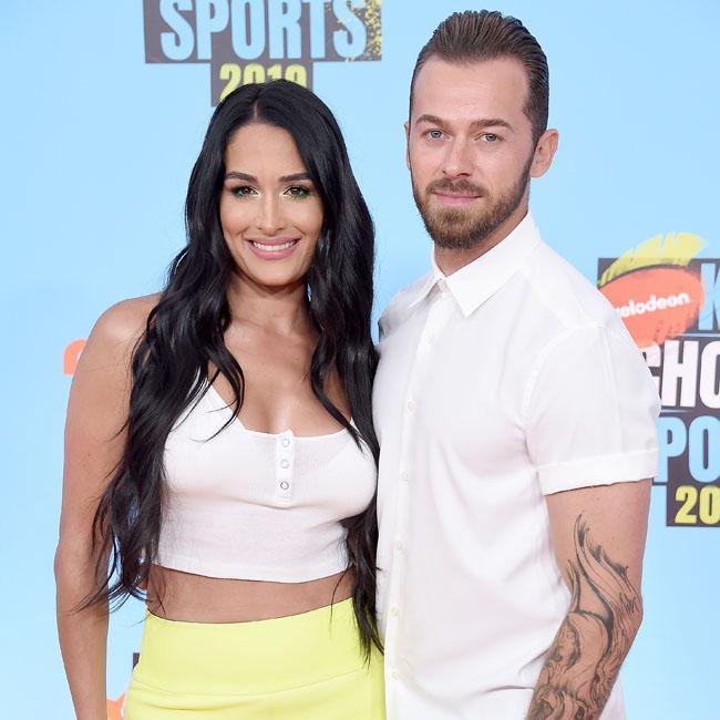 Nikki Bella ran away on first date with Artem Chigvinstev