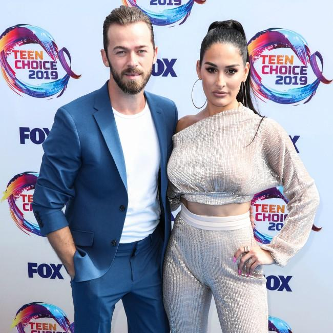 Artem Chigvintsev has learned to accept Nikki Bella's candid nature