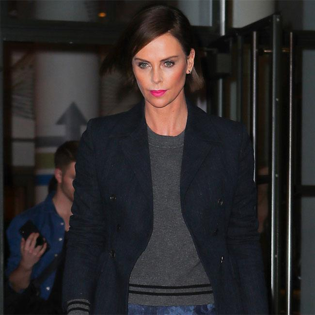 Charlize Theron jokes she's in a thruple with Nicole Kidman and Margot Robbie