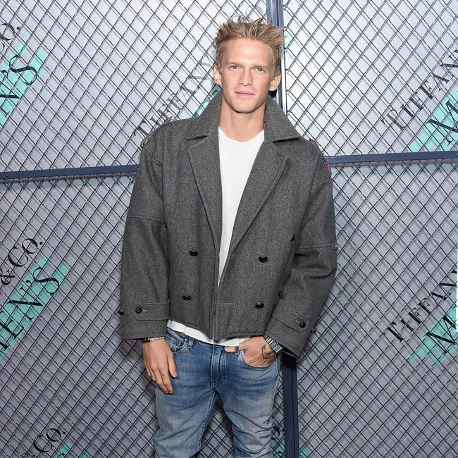 Cody Simpson and Miley Cyrus are official and 'very happy' together
