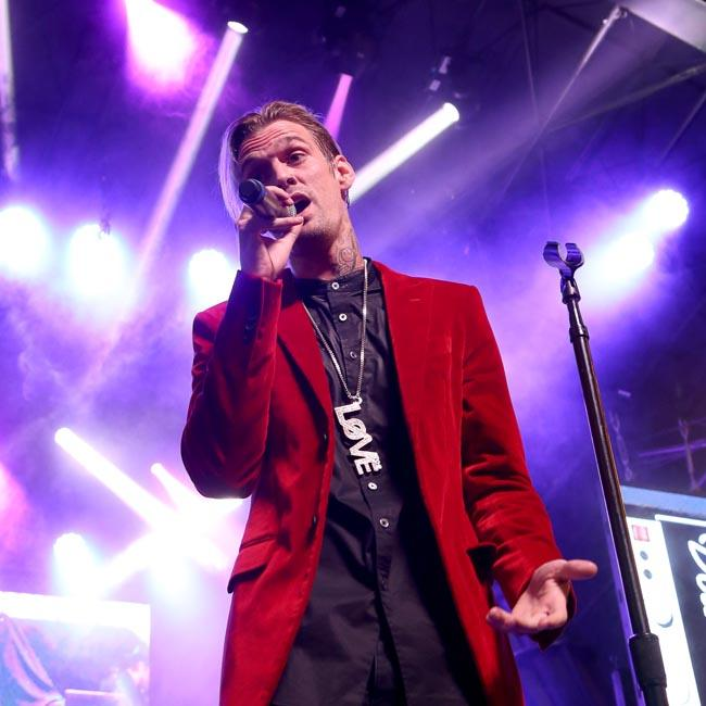 Aaron Carter calls for 'peace and love' after lashing out at brother Nick