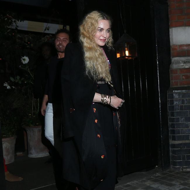 Madonna postpones show after injuring knee