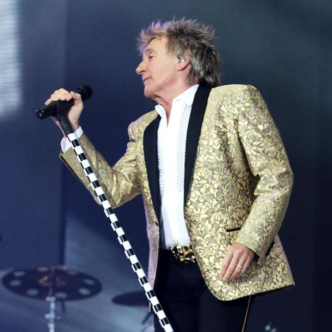 Sir Rod Stewart wears socks and a vest in bed
