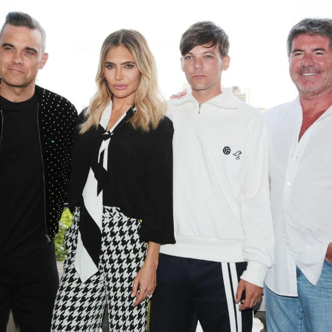 Robbie Williams loved not being centre of attention on X Factor