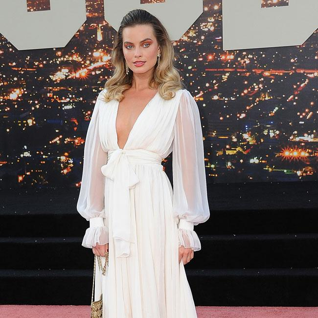 Margot Robbie says 'going dark' on screen is much easier