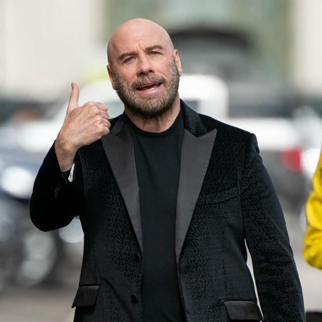 John Travolta plays Monopoly with real money