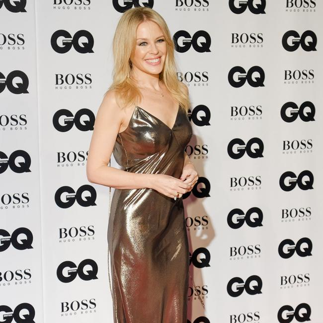 Kylie Minogue and Robbie Williams sitting on another duet