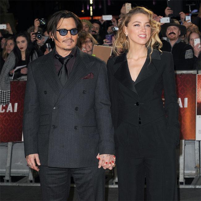 Amber Heard's dad 'made shooting threat' towards Johnny Depp