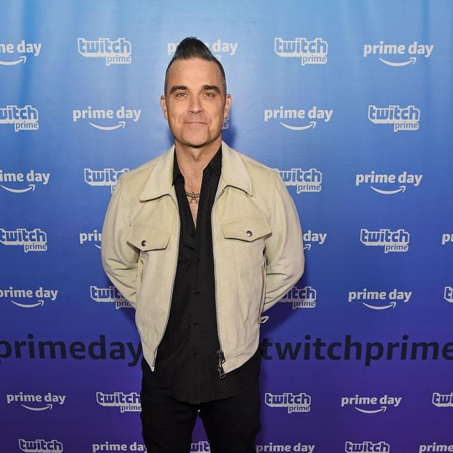 Robbie Williams: I still love working
