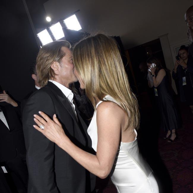 Brad Pitt and Jennifer Aniston kiss and hold hands at SAG Awards