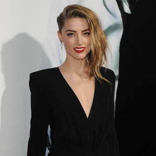 Amber Heard 'happier than ever' with new girlfriend