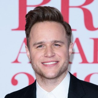 Olly Murs is 'so happy' in his relationship